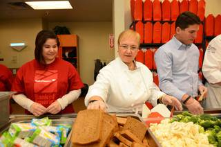Lidia Bastianich at Three Square on Wednesday, Dec. 4, 2013, in Las Vegas. Lou Garate of NASCAR also joined her at the food bank.