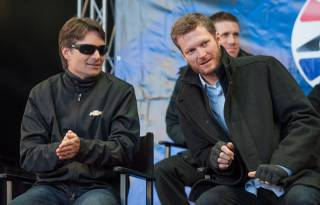 Jeff Gordon and Dale Earnhardt Jr. attend Fan Fest at Fremont Street Experience in downtown Las Vegas on Wednesday, Dec. 4, 2013, for 2013 NASCAR Champion's Week.