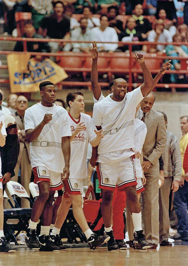 UNLV Runnin' Rebels, from left, Evric Gray, Bobby Joyce, H Waldman and Melvin Love celebrate upon winning their second-round NCAA game against Georgetown in Tucson, Ariz., March 17, 1991.