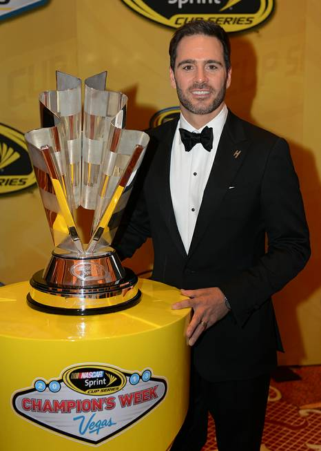 Jimmie Johnson stands with his sixth championship trophy after the ...