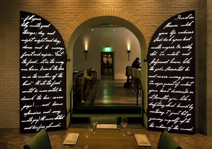 Laser-cut steel doors with illuminated lettering are a distinctive feature at the new restaurant Crush in MGM Grand pictured here on Friday, Dec. 6, 2013.