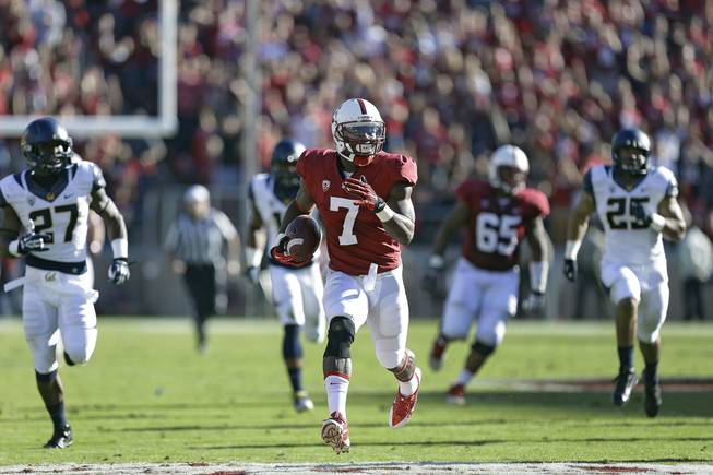 Stanford wide receiver Ty Montgomery (7) runs for a touchdown against California defenders during the first half of an NCAA college football game in Stanford, Calif., Saturday, Nov. 23, 2013.