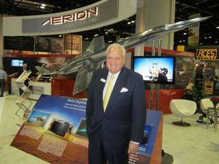 Brian Barents, vice chairman of Aerion Corp., at Aerion's exhibit at the National Business Aviation Association's convention in Orlando, Fla., earlier this month. Behind him is Aerion's design of a supersonic business jet. Molly McMillin/Wichita Eagle