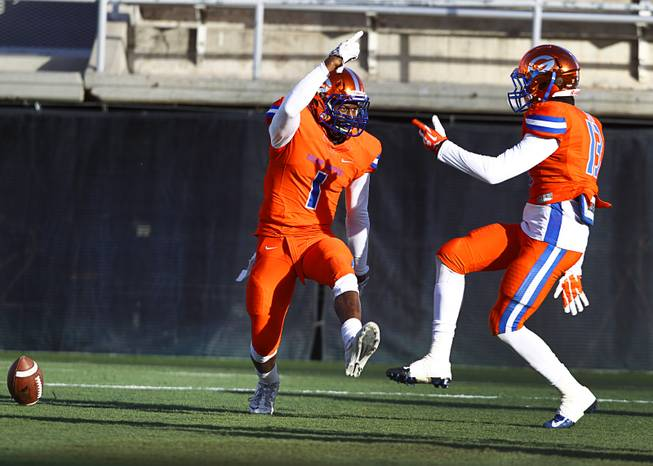 Bishop Gorman High School's Daniel Stewart (L) celebrates with teammate Armand Perry (13) during their Division I state high school football championship game against Reed High School of Sparks, Nev. at Sam Boyd Stadium Saturday, Dec. 7, 2013.