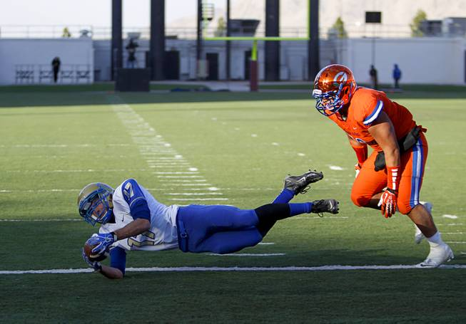 Reed High School's Jake Lehmann (17) makes a diving touchdown catch during their Division I state high school football championship game against Bishop Gorman at Sam Boyd Stadium Saturday, Dec. 7, 2013.
