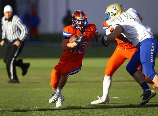 Bishop Gorman High School's Jonathan Shumaker (33) carries the ball during their Division I state high school football championship game against Reed High School of Sparks, Nev. at Sam Boyd Stadium Saturday, Dec. 7, 2013.