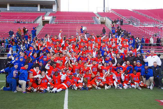 Bishop Gorman High School players and coaches pose for a team portrait after defeating Reed High School of Sparks, Nev. in the Division I state high school football championship game at Sam Boyd Stadium Saturday, Dec. 7, 2013.