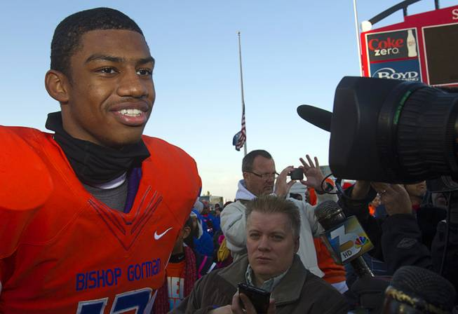 Bishop Gorman High School quarterback Randall Cunningham Jr. talks with reporters after the team defeated Reed High School of Sparks, Nev. in the Division I state high school football championship game at Sam Boyd Stadium Saturday, Dec. 7, 2013.