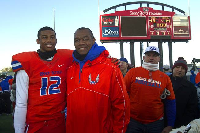 Bishop Gorman High School quarterback Randall Cunningham Jr. poses with his father after the team defeated Reed High School of Sparks, Nev. in the Division I state high school football championship game at Sam Boyd Stadium Saturday, Dec. 7, 2013.