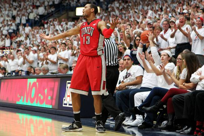 UNLV guard Bryce Dejan Jones reacts after teammate Deville Smith's pass went wide and into the seats of the McKale Center late in their game against Arizona Saturday, Dec. 7, 2013. Arizona won the game 63-58.