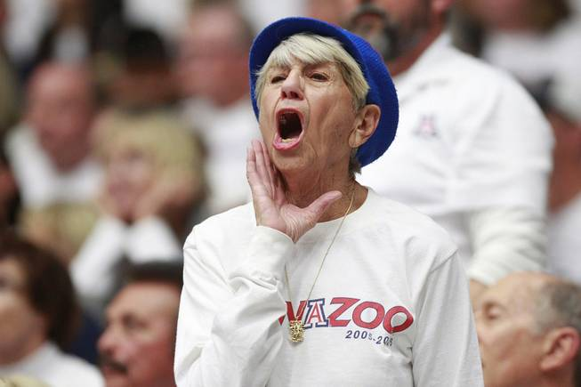 An Arizona fan yells her disapproval about a call during their game against UNLV at the McKale Center in Tucson Saturday, Dec. 7, 2013. Arizona won the game 63-58.