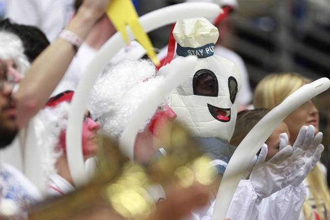 An Arizona fan dressed as the Stay Puft Marshmallow Man cheers on the Wildcats against UNLV during their game at the McKale Center in Tucson Saturday, Dec. 7, 2013. Arizona won the game 63-58.