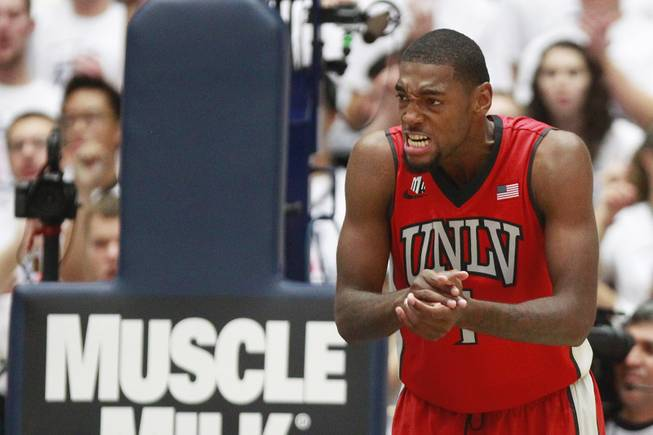 UNLV forward Roscoe Smith gets animated during the first half of their game against Arizona at the McKale Center in Tucson Saturday, Dec. 7, 2013. Arizona won the game 63-58.