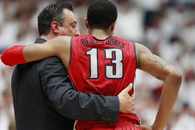 UNLV assistant coach Heath Schroyer talks with guard Bryce Dejan Jones during a time out in their game against Arizona at the McKale Center in Tucson Saturday, Dec. 7, 2013. Arizona won the game 63-58.