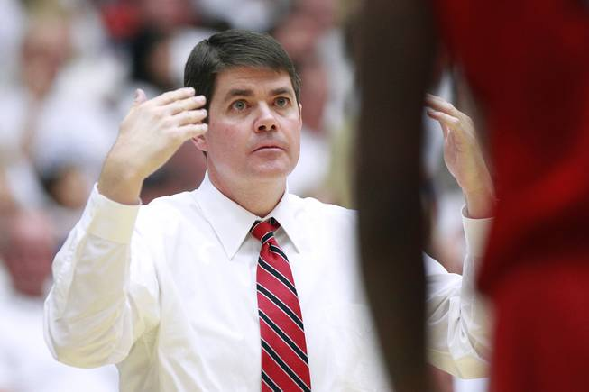 UNLV head coach Dave Rice motions his players to the bench during a break in their game against Arizona at the McKale Center in Tucson Saturday, Dec. 7, 2013. Arizona won the game 63-58.