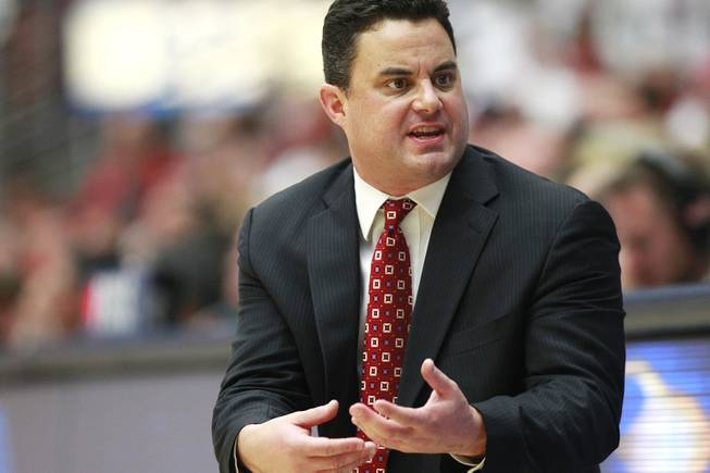 Arizona head coach Sean Miller talks to his team during their game against UNLV at the McKale Center in Tucson Saturday, Dec. 7, 2013. Arizona won the game 63-58.