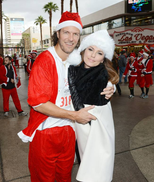 Shania Twain meets her husband Frederic Thiebaud at the finish line after his participation in the 2013 Great Santa Run in downtown Las Vegas on Saturday, Dec. 7, 2013.
