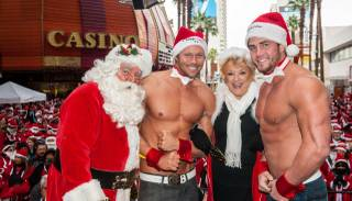 Santa Claus, Jace Crispin of Chippendales at the Rio, Mayor Carolyn Goodman and Gavin McHale attend the 2013 Great Santa Run on Saturday, Dec. 7, 2013, in downtown Las Vegas.