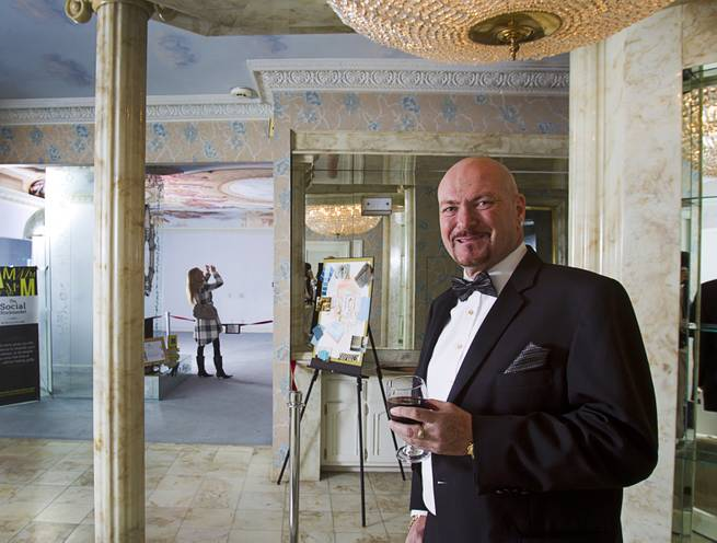 "British businessman Martyn J. Ravenhill hosts an open house and book signing at the Liberace house Monday, Dec. 9, 2013. Ravenhill purchased Liberace's former residence for $500,000 in August. He also recently published a book titled ""The Social Stockmarket."""