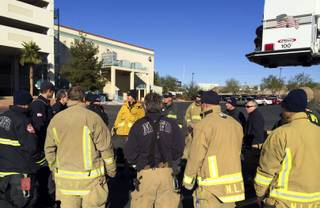 The North Las Vegas Fire Department gathers during training exercises at the Fiesta Casino parking garage Monday morning, Dec. 9, 2013.
