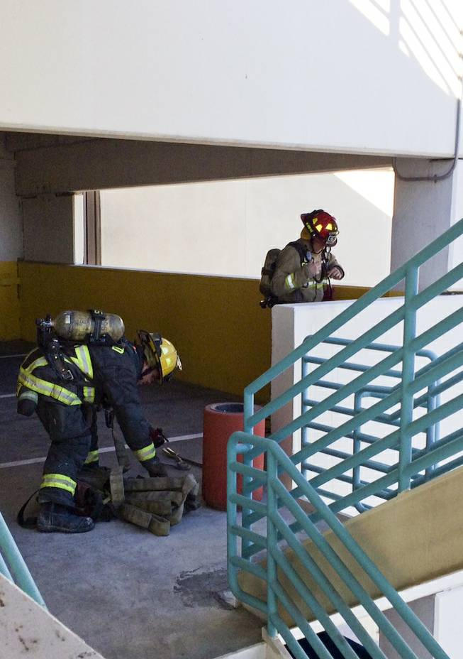 Firefighters from the North Las Vegas Fire Department prepare for a drill during training exercises in the Fiesta Casino parking garage Monday morning, Dec. 9, 2013.