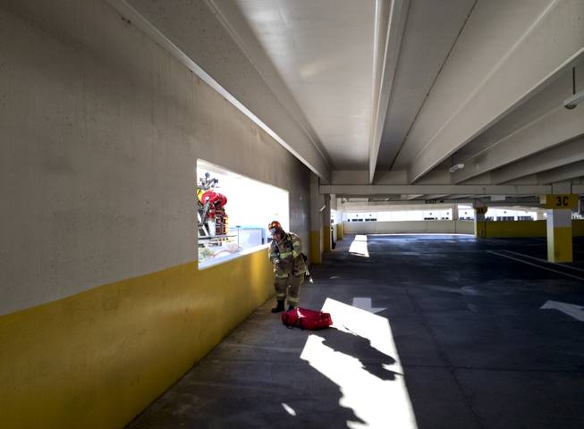 A North Las Vegas Fire Department firefighter participates in a training exercise at the Fiesta Casino parking garage Monday morning, Dec. 9, 2013.