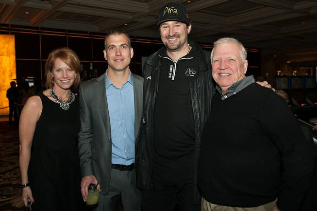 Nikki Balsbaugh, Poker Royalty CEO and founder Brian Balsbaugh, Phil Hellmuth and Mike Balsbaugh at Bellagio.