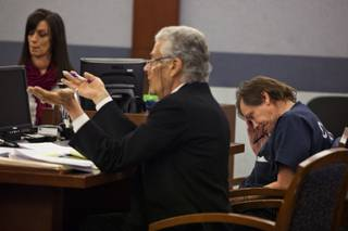 Defense attorney John Momot presents an argument for Melvyn Sprowson looking down during a preliminary hearing on Monday,  Dec. 9, 2013.