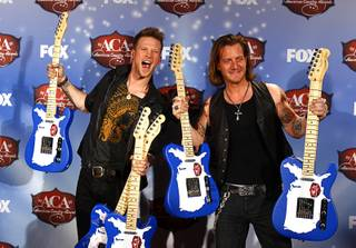 Brian Kelley and Tyler Hubbard of Florida Georgia Line stand with their awards during the 4th annual American Country Awards at Mandalay Bay Events Center on Tuesday, Dec. 9, 2013. The duo won six awards, including New Artist of the Year.