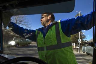 Jerry Bates starts his route with clean windows as a driver with the Republic Services recycling truck on Tuesday, Dec. 10, 2013.  L.E. Baskow