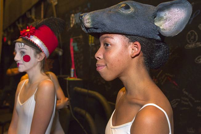 "Toy solder Sydney Carrigan, 12, and mouse Jahisha Williams, 16, wait backstage during rehearsal for Nevada Ballet Theater's ""The Nutcracker"" at the Smith Center for the Performing Arts on Wednesday, Dec. 11, 2013. The annual performance opens Saturday and runs through Dec. 22."