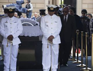 South African President Jacob Zuma pays his respects to former South African President Nelson Mandela during the lying in state at the Union Buildings in Pretoria, South Africa, Wednesday, Dec. 11, 2013.