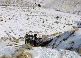 This Tuesday, Dec. 10, 2013, photo provided by searcher Lucia Gonzalez shows the vehicle belonging to a family who went missing after a trip to play in the snow near Lovelock, Nev.
