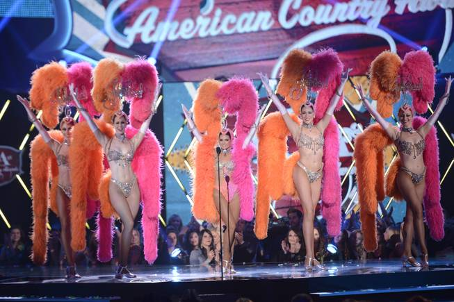 "Co-host Danica Patrick appears onstage with dancers from ""Jubilee!"" at Bally's during the 2013 American Country Awards on Tuesday, Dec. 10, 2013, at Mandalay Bay Events Center in Las Vegas."