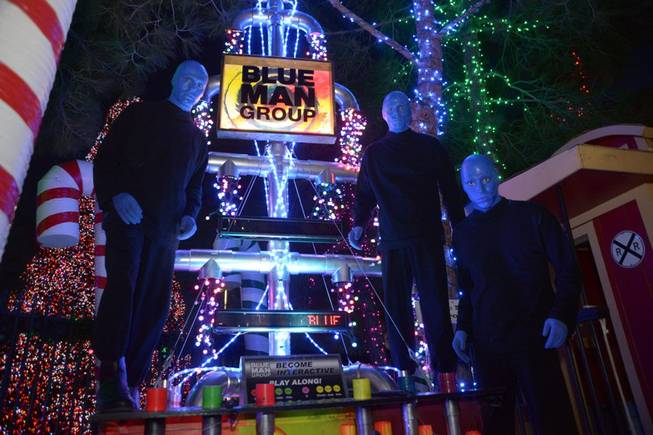 Blue Man Group at their Christmas tree in the Magical Forest of Opportunity Village on Monday, Dec. 9, 2013.