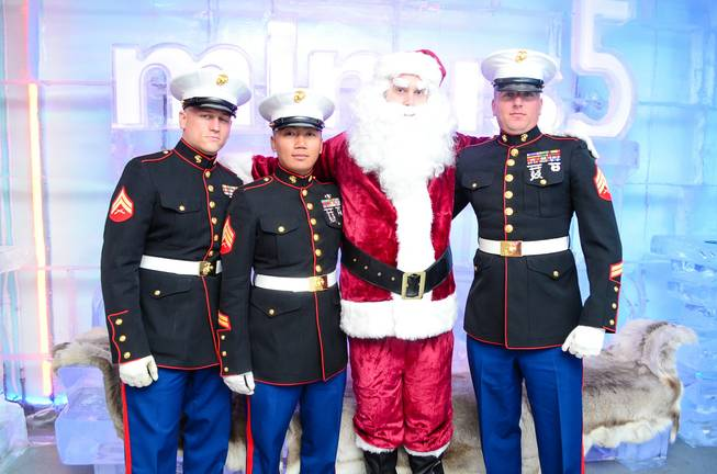 Marine Cpl. Baker, Sgt. Yommalat, Santa Claus and Sgt. Ringgold at the Toys for Tots drive at Minus 5 Ice Bar in Mandalay Place.