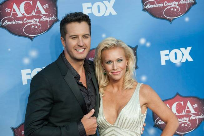 Luke Bryan and his wife, Caroline, arrive at the 2013 ...