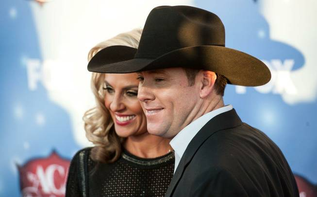 Trevor Brazile and his wife, Shada, arrive at the 2013 ...