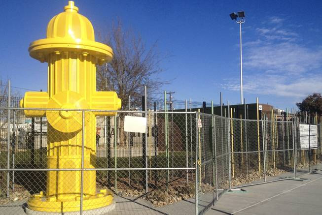 "A 14-foot yellow fire hydrant is the trademark of the Hydrant Club, billed as an ""urban social club and training academy for dogs and their people,"" downtown at the corner of 9th and Fremont streets."