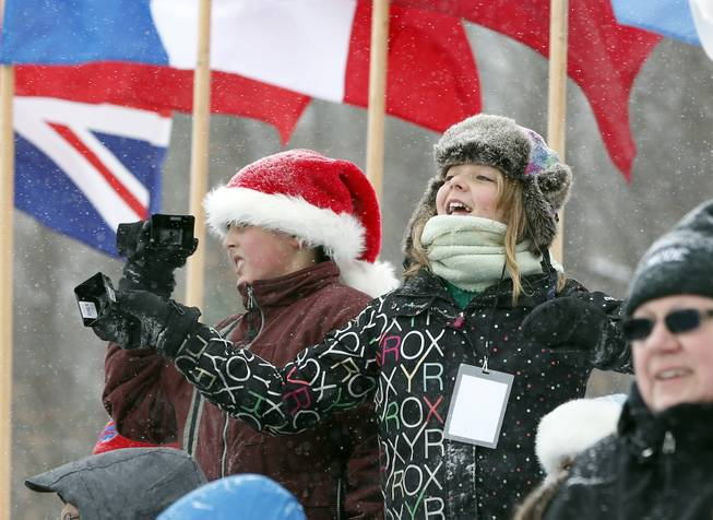 Fans cheer on athletes during the two-man bobsled World Cup event on Friday, Dec. 13, 2013, in Lake Placid, N.Y.