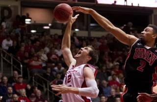 UNLV's Khem Birch swats the ball away from Southern Utah's Jaren Jeffery during their game Saturday Dec. 14, 2013, in Cedar City, Utah.