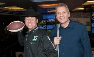 World champion rodeo cowboy Trevor Brazile and NFL Hall of Famer Joe Montana at Lagasse's Stadium on Saturday, Dec. 14, 2013, in Palazzo.