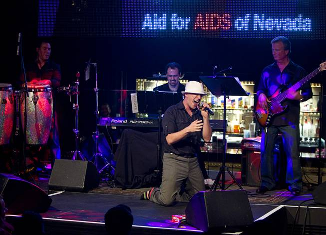 "Martin Kaye performs during ""Monday's Dark"" with Mark Shunock, a monthly charitable event, at Body English nightclub at the Hard Rock Hotel Monday Dec. 16, 2013. Proceeds from the event benefited local nonprofit Aid for Aids of Nevada (AFAN)."