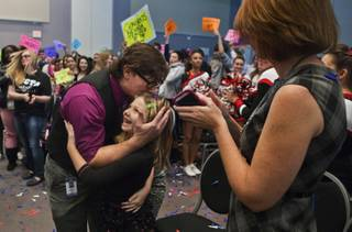 Northwest Career & Technical Academy teacher Jeff Hinton hugs his daughter Sophie, 6, as he steps up to receive the Nevada Teacher of the Year Award on Wednesday, Dec. 18, 2013.