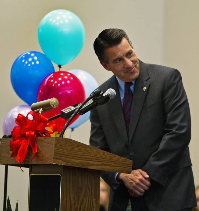 Gov. Brian Sandoval talks about the importance of education to students and invited guests at the Northwest Career & Technical Academy for the Nevada Teacher of the Year Award ceremony on Wednesday, Dec. 18, 2013.