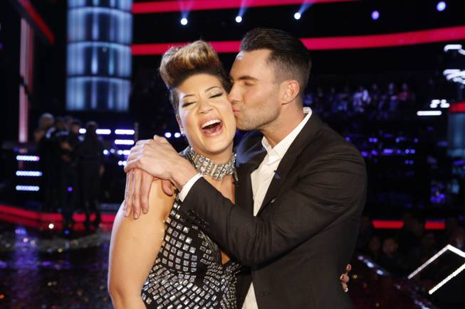 "Maroon 5 frontman Adam Levine kisses Tessanne Chin on the cheek after Chin was announced the Season 5 winner of ""The Voice"" on NBC on Tuesday, Dec. 17, 2013, in Los Angeles."