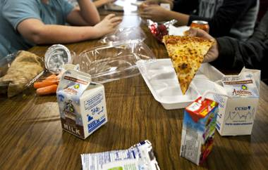 Pizza and other selections are eaten for lunch by students in the Greenspun Middle School cafeteria on Thursday, Dec. 19, 2013.