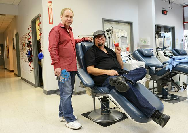 Rio magician headliners Penn & Teller donate blood on Wednesday, Dec. 18, 2013.