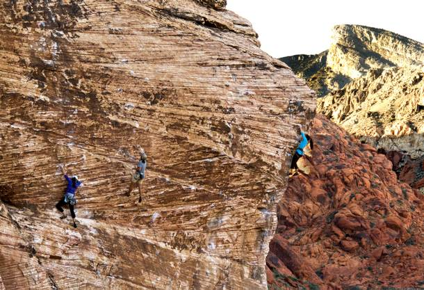 Climbers scale the rock face within the Red Rock Canyon National Conservation Area which encompasses 195,819 acres within the Mojave Desert, Tuesday, Nov. 11, 2013.