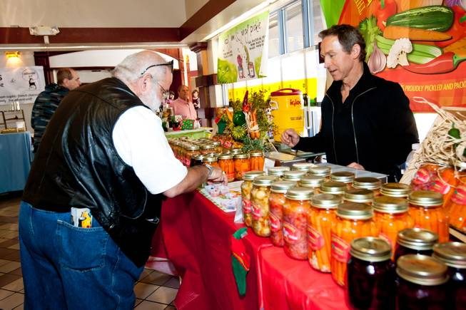 Carlos Mijares selects a sample in Nick Kreway's The Pickled Pantry booth at the Downtown Farmers' Market in Las Vegas Friday, December 20, 2013.
